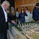 UBC Director of Campus Planning gesturing towards model